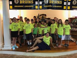The Red Group posed for a picture with Blades (the Bruins' mascot)